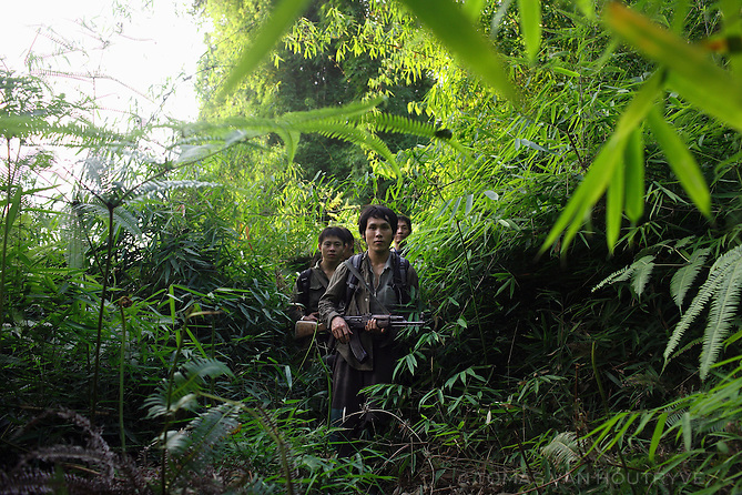 Ethnic Hmong relatives of CIA Secret War veterans walk through the jungle in the Vientiane province of Laos on 28 November 2007. Thousands of Hmongs who fought or collaborated with the American CIA until communists took over the country in 1975 remain hidden in the jungles of Laos