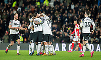 31st January 2020; Pride Park, Derby, East Midlands; English Championship Football, Derby County versus Stoke City; Wayne Rooney of Derby County celebrates with his team mates after scoring from a free kick in the 67th minute for 3-0