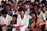 Inside Sunday morning Christian church services in Sri Lanka. family child with Christian Bible, activities, religions, crowd scene, Christianity. Congregation in Christian Church. Colombo, Sri Lanka Christian Church Services.
