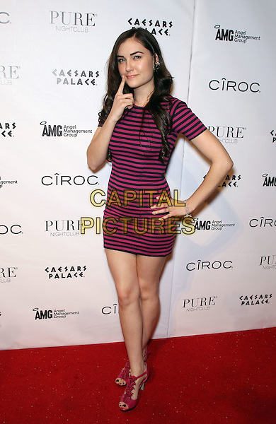 SASHA GREY.hosts a seductive night at Pure Nightclub inside Caesar's Palace Resort Hotel and Casino, Las Vegas, Nevada, USA, .7th January 2011..full length pink and black striped dress mini ruffle sandals shoes open toe t-bar navy blue hand on hip pointing finger .CAP/ADM/MJT.© MJT/AdMedia/Capital Pictures.