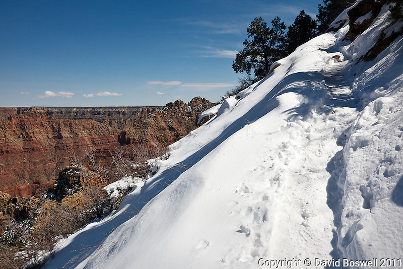 Snow from an early spring storm covers the Grandview Trail below the South Rim of the Grand Canyon.