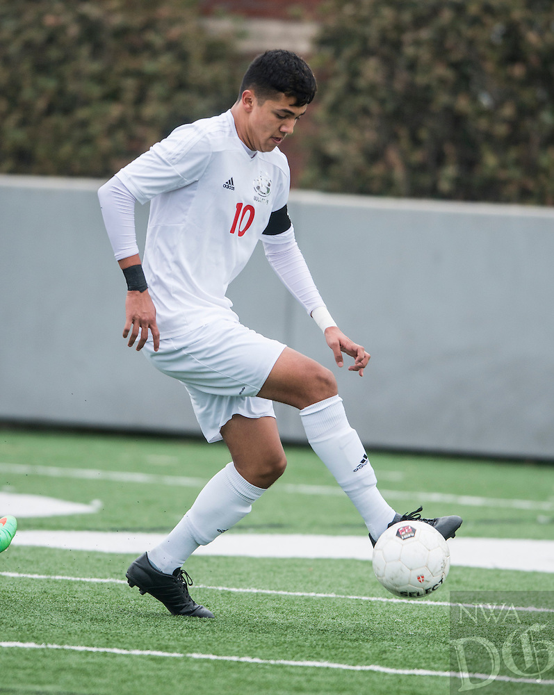 NWA Democrat-Gazette/ANTHONY REYES &bull; @NWATONYR<br /> Amilcar Gonzalez, Springdale sophomore, with the ball against Fort Smith Northside Thursday, March 19, 2015 at Bulldog Stadium in Springdale. The Bulldogs won on penalty kicks after a 2-2 tie at the end of regulation.