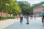 Students have a laugh on Galtney-Lott plaza.  Photo by Kevin Bain/Ole Miss Communications