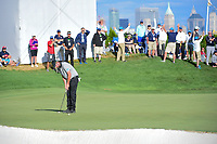 Marc Leishman (AUS) sinks his putt on 14 during round 2 Four-Ball of the 2017 President's Cup, Liberty National Golf Club, Jersey City, New Jersey, USA. 9/29/2017.<br /> Picture: Golffile | Ken Murray<br /> <br /> All photo usage must carry mandatory copyright credit (&copy; Golffile | Ken Murray)