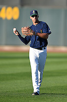 Cedar Rapids Kernels outfielder Zack Larson (23) warms up before a game against the Quad Cities River Bandits on August 18, 2014 at Perfect Game Field at Veterans Memorial Stadium in Cedar Rapids, Iowa.  Cedar Rapids defeated Quad Cities 4-2.  (Mike Janes/Four Seam Images)