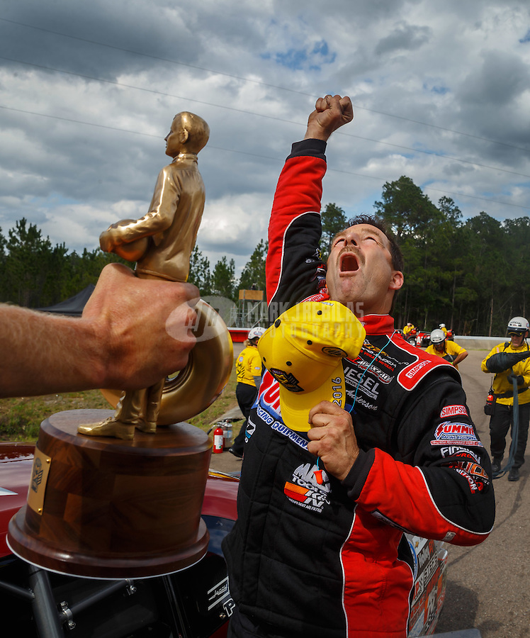 Mar 20, 2016; Gainesville, FL, USA; NHRA pro stock driver Greg Anderson celebrates after winning the Gatornationals at Auto Plus Raceway at Gainesville. Mandatory Credit: Mark J. Rebilas-USA TODAY Sports