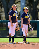 Michigan Wolverines Softball shortstop Sierra Romero (32) and infielder Abby Ramirez (1) during a game against the Bethune-Cookman on February 9, 2014 at the USF Softball Stadium in Tampa, Florida.  Michigan defeated Bethune-Cookman 12-1.  (Copyright Mike Janes Photography)
