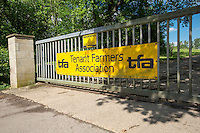 Tenant Farmer Association banner on farm gate
