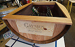 A table that Dave Cahput, owner of the Live Oak Wine Decor business, was working on. It has storage for a dozen wine bottles inside, and will have an engraved Lazy Susan on the top.
