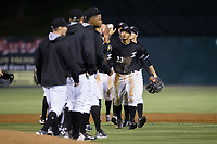Joel Booker (23) of the Kannapolis Intimidators celebrates with his teammates following their win over the Augusta GreenJackets at Kannapolis Intimidators Stadium on May 3, 2017 in Kannapolis, North Carolina.  The Intimidators defeated the GreenJackets 7-4.  (Brian Westerholt/Four Seam Images)