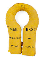 "BNPS.co.uk (01202 558833)<br /> Pic:  Julien's/BNPS<br /> <br /> Mae West's very own 'Mae West' - the inflatable life jackets became named after the buxom bombshell during WW2.<br /> <br /> A US Navy life jacket with Mae West inscribed on it, est. £1,600.<br /> <br /> A selection of trailblazing 1930s starlet Mae West's most recognisable film costumes have emerged for sale for £320,000. ($400,000)<br /> <br /> The auction features the actress and screenwriter's gowns, headdresses and tiaras, as well as props from her films and her scripts.<br /> <br /> West, a New York native, was the Marilyn Monroe of her era, earning a 'bad girl' reputation for starring in risque productions.<br /> <br /> She famously coined the phrase: ""When I'm good, I'm very good, but when I'm bad, I'm better."""
