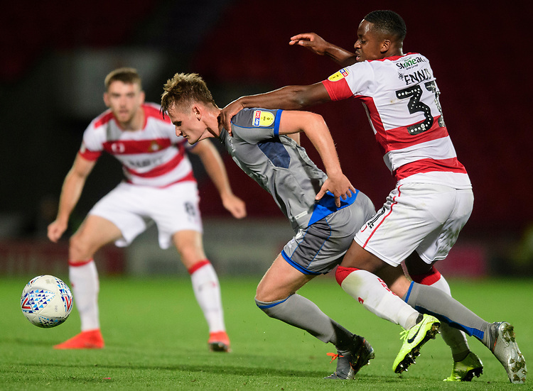 Lincoln City's Callum Connolly is fouled by Doncaster Rovers' Niall Ennis<br /> <br /> Photographer Chris Vaughan/CameraSport<br /> <br /> EFL Leasing.com Trophy - Northern Section - Group H - Doncaster Rovers v Lincoln City - Tuesday 3rd September 2019 - Keepmoat Stadium - Doncaster<br />  <br /> World Copyright © 2018 CameraSport. All rights reserved. 43 Linden Ave. Countesthorpe. Leicester. England. LE8 5PG - Tel: +44 (0) 116 277 4147 - admin@camerasport.com - www.camerasport.com