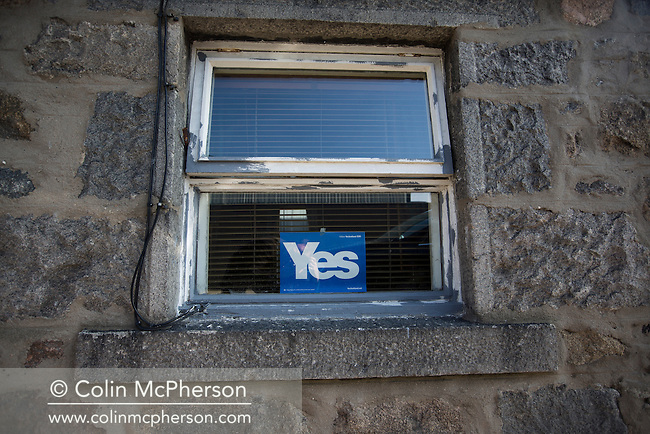 A pro-independence Yes sign in a window in the historic Footdee area of Aberdeen, a traditional fishing village which sits next to the city's harbour, Scotland's North Sea oil and gas transportation and maintenance hub. Issues surrounding oil and gas has been one of the key political battlegrounds between supporters of Scottish independence and those who prefer Scotland to remain within the United Kingdom. On the 18th of September 2014, the people of Scotland voted in a referendum to decide whether the country's union with England should continue or Scotland should become an independent nation once again and leave the United Kingdom.