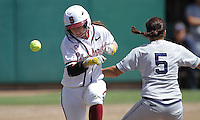 STANFORD, CA - April 3, 2011:  Sarah Hassman runs out an infield hit while the ball gets past the Arizona 1st baseman during Stanford's 2-0 loss to Arizona at Stanford, California on April 3, 2011.