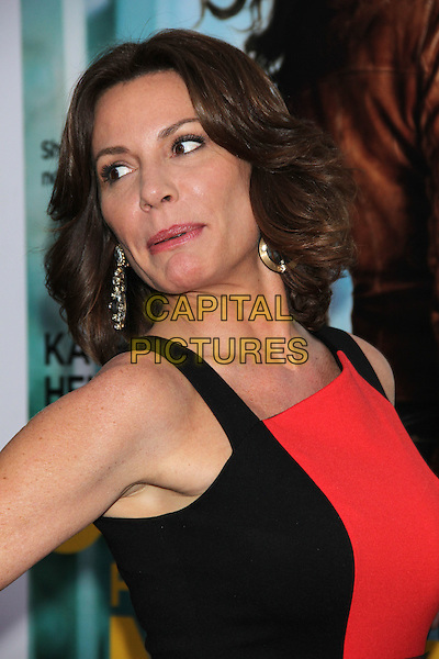"LuAnn de Lesseps ('The Real Housewives of New York City').The New York Premiere of ""One For The Money"" held at the AMC Loews Lincoln Square Cinemas, New York, NY, USA..January 24th, 2012.headshot portrait looking over shoulder red black sleeveless  .CAP/LNC/TOM.©LNC/Capital Pictures."