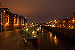 Lights reflected on the waterways of the Speicherstadt old town. Customs houses, warehouse and dock areas of Hamburg, Germany.