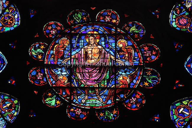 Central section of the Rose window of the South transept, with Christ surrounded by the 4 Evangelist symbols, 13th century, in the Cathedrale Notre-Dame de Reims or Reims Cathedral, Reims, Champagne-Ardenne, France. The cathedral was built 1211-75 in French Gothic style with work continuing into the 14th century, and was listed as a UNESCO World Heritage Site in 1991. Picture by Manuel Cohen