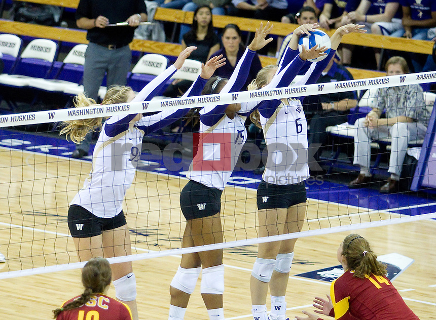 Bianca Rowland, Kaleigh Nelson, Summer Ross The University of Washington women's volleyball team plays USC Trojans at Alaska Airlines Arena at the University of Washington in Seattle on Friday September 16, 2011. (Photography By Scott Eklund/Red Box Pictures)