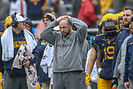 West Virginia coaching staff in action during the Zaxby's Heart of Dallas Bowl game between the Utah Utes vs. West Virginia Mountaineers at the Cotton Bowl Stadium in Dallas, Texas.