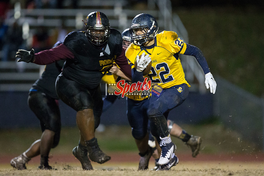 Tyree Hallman (22) of the South Iredell Vikings looks for running room during second half action against the JM Robinson Bulldogs at South Iredell High School November 20, 2015, in Statesville, North Carolina.  The Vikings defeated the Bulldogs 14-13.  (Brian Westerholt/Special to the Tribune)