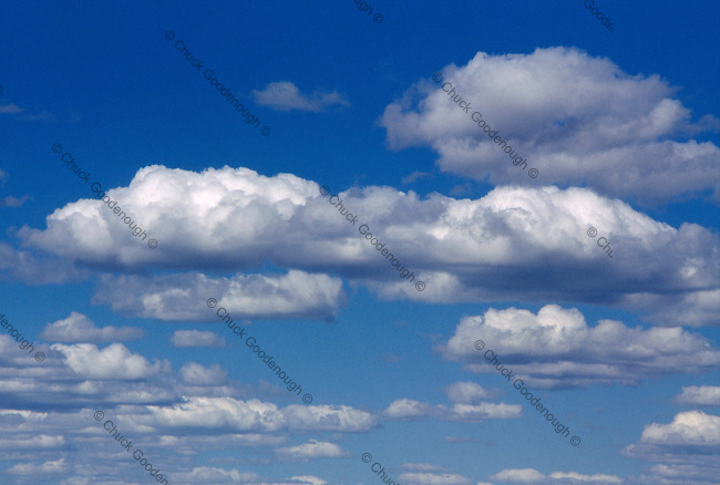Stock Photo of Dramatic Clouds against a Deep Blue Sky