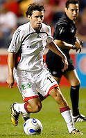 New England Revolution defender Michael Parkhurst (15) dribbles the ball.  The Chicago Fire defeated the New England Revolution 2-1 in the quarterfinals of the U.S. Open Cup at Toyota Park in Bridgeview, IL on August 23, 2006...