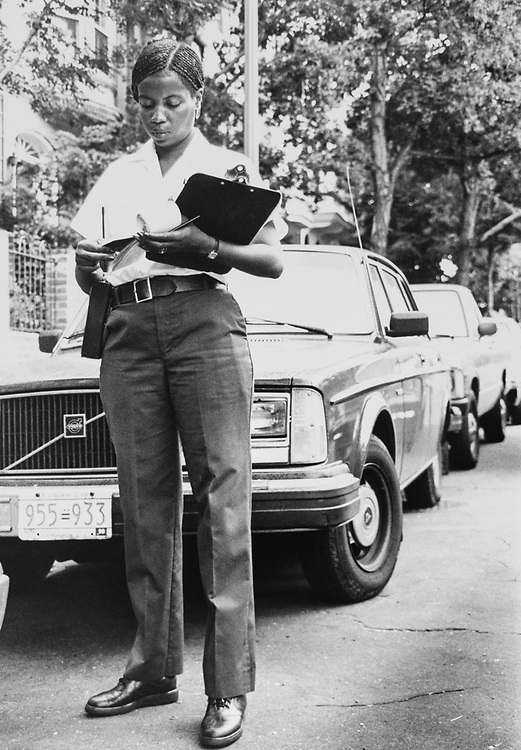 Shirley Jones writing a parking ticket. She is an Parking Enforcement Officer for the Bureau of Parking Services under the Jurisdiction of Department of Public Work on Aug. 10, 1989. (Photo by Maureen Keating/CQ Roll Call via Getty Images)