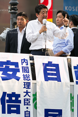 Shinzo Abe, leader of the Liberal Democratic Party and Prime Minister of Japan speak during a campaign event of the candidate Kentaro Asahi, former beach volleyball star, in Shibuya on July 3, 2016, Tokyo, Japan. Abe came to support Asahi's campaign for July 10th's House of Councillors elections. (Photo by Rodrigo Reyes Marin/AFLO)