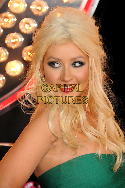 """CHRISTINA AGUILERA .""""Burlesque"""" Los Angeles Premiere held at Grauman's Chinese Theatre, Hollywood, California, USA, .15th November 2010..portrait headshot green strapless red lipstick make-up smiling eyeshadow beauty wavy hair side over shoulder .CAP/ADM/BP.©Byron Purvis/AdMedia/Capital Pictures."""