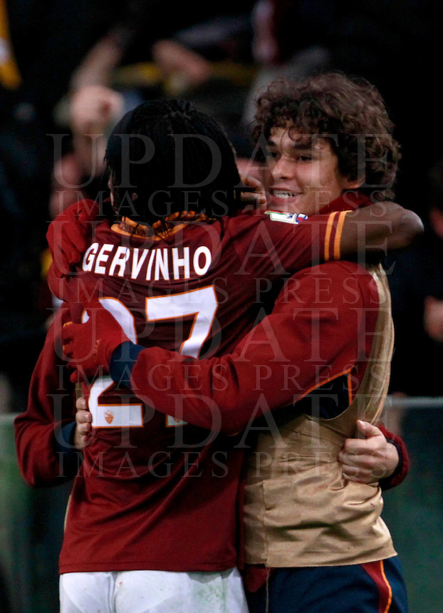 Calcio, quarti di finale di Coppa Italia: Roma vs Juventus. Roma, stadio Olimpico, 21 gennaio 2014.<br /> AS Roma forward Gervinho, of Ivory Coast, celebrates with teammate Dodo', of Brazil, right, after scoring the winning goal during the Italian Cup round of eight final football match between AS Roma and Juventus, at Rome's Olympic stadium, 21 January 2014.<br /> UPDATE IMAGES PRESS/Isabella Bonotto