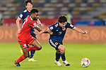 Minamino Takumi of Japan (R) competes for the ball with Harib Al Saadi of Oman (L) during the AFC Asian Cup UAE 2019 Group F match between Oman (OMA) and Japan (JPN) at Zayed Sports City Stadium on 13 January 2019 in Abu Dhabi, United Arab Emirates. Photo by Marcio Rodrigo Machado / Power Sport Images