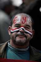 A man with his face painted in the colors of the Egyptian flag durin Friday prayers at Tahrir square.