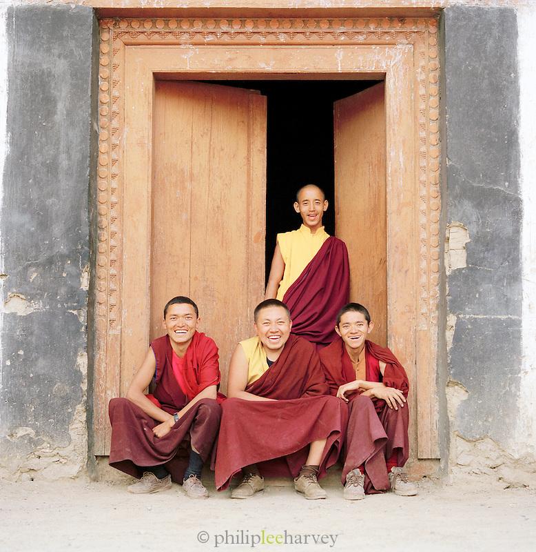 Portrait of monks by monastery doorway, Ladakh, India