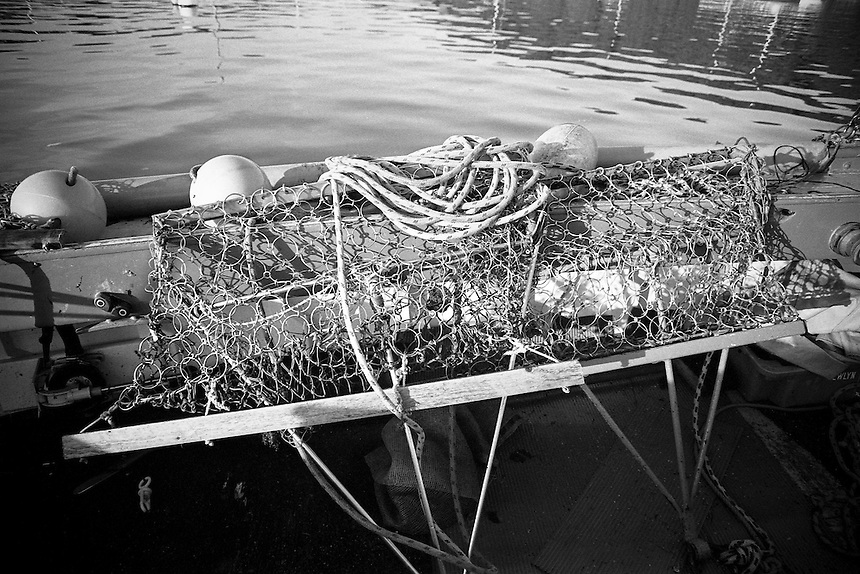 Hand-pulled dredges on a boat at Mylor Creek, Cornwall. Governed by ancient laws that were put in place to protect the natural ecology of the riverbeds and oyster stocks, oyster fishing in the Port of Truro Oyster Fishery are prohibited from using engines. Instead, sail power and hand-pulled dredges must be used.