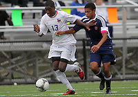 HYATTSVILLE, MD - OCTOBER 26, 2012:  Arion Sobers-Assue (13) of DeMatha Catholic High School gets away from Chris Yungu (14) of St. Albans during a match at Heurich Field in Hyattsville, MD. on October 26. DeMatha won 2-0.