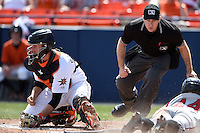 Frederick Keys catcher Wynston Sawyer (18) takes a throw as a runner slides in safely with umpire Brian Peterson watching the play during a game against the Carolina Mudcats on April 26, 2014 at Harry Grove Stadium in Frederick, Maryland. Carolina defeated Frederick 4-2. (Mike Janes/Four Seam Images)