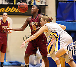 BROOKINGS, SD - JANUARY 9:  Akilah Sims #30 from IUPUI tries to control the ball after Chynna Stevens #0 from South Dakota State University knocks it loose in the first half of their game Thursday night at Frost Arena in Brookings. (Photo by Dave Eggen/Inertia)