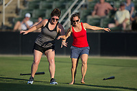 Two fans compete in the dizzy bat race between innings of the South Atlantic League game between the Delmarva Shorebirds and the Kannapolis Intimidators at Kannapolis Intimidators Stadium on July 2, 2017 in Kannapolis, North Carolina.  The Shorebirds defeated the Intimidators 5-4.  (Brian Westerholt/Four Seam Images)