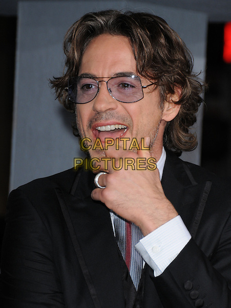 "ROBERT DOWNEY JR..at The Warner Bros. Pictures' L.A. Premiere of ""Due Date"" held at The Grauman's Chinese Theatre in Hollywood, California, USA,.October 28th 2010..portrait headshot glasses  beard facial hair tie hand over mouth ring open .CAP/RKE/DVS.©DVS/RockinExposures/Capital Pictures."