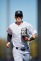 New York Yankees left fielder Zach Zehner (93) jogs back to the dugout during a Grapefruit League Spring Training game against the Toronto Blue Jays on February 25, 2019 at George M. Steinbrenner Field in Tampa, Florida.  Yankees defeated the Blue Jays 3-0.  (Mike Janes/Four Seam Images)