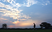 United States President George W. Bush is silhouetted against an early morning sky after a run at his ranch in Crawford, Texas, Friday, August 9, 2002. <br /> Mandatory Credit: Eric Draper - White House via CNP