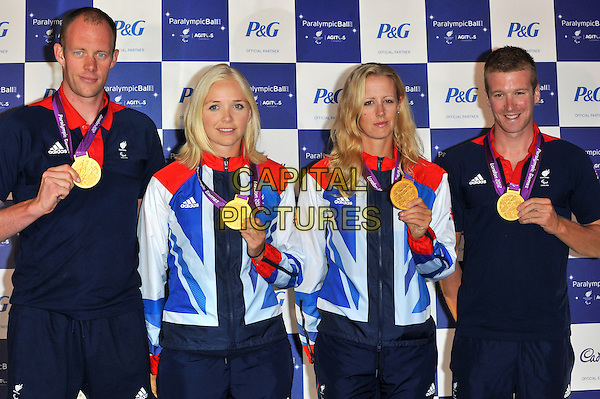 gold medal winners for mixed coxed fours, ( l to r ) David Smith, Pamela Relph, Naomi Riches & James Roe.The Paralympic Ball in aid of the British Paralympic Association & the Agitos Foundation, Grosvenor House Hotel, Park Lane, London, England..September 5th, 2012.half length athletes blue white red tracksuit .CAP/CJ.©Chris Joseph/Capital Pictures.