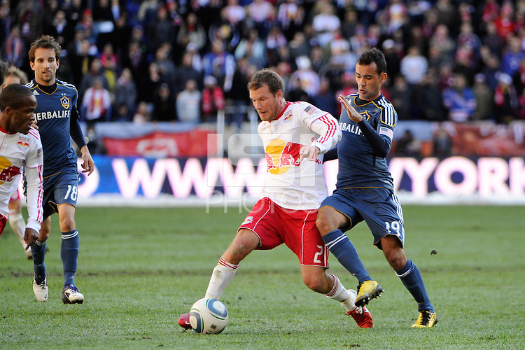 Teemu Tainio (2) of the New York Red Bulls is defended by Juninho (19) of the Los Angeles Galaxy during the 1st leg of the Major League Soccer (MLS) Western Conference Semifinals at Red Bull Arena in Harrison, NJ, on October 30, 2011.