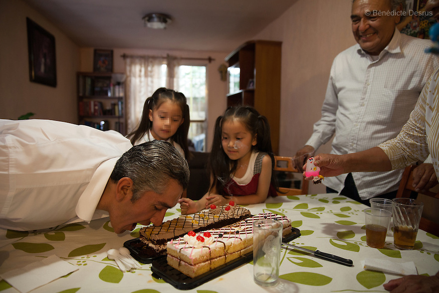 "Donovan celebrates his 43rd birthday with his family at his home in Texcoco, Mexico on May 9, 2015. Donovan Tavera, 43, is the director of ""Limpieza Forense México"", the country's first and so far the only government-accredited forensic cleaning company. Since 2000, Tavera, a self-taught forensic technician, and his family have offered services to clean up homicides, unattended death, suicides, the homes of compulsive hoarders and houses destroyed by fire or flooding. Despite rising violence that has left 70,000 people dead and 23,000 disappeared since 2006, Mexico has only one certified forensic cleaner. As a consequence, the biological hazards associated with crime scenes are going unchecked all around the country. Photo by Bénédicte Desrus"
