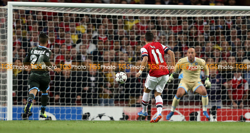 Mesut Ozil scores the 1st goal for Arsenal - Arsenal vs Napoli, Champions League Group F game at the Emirates Stadium, Arsenal - 01/10/13 - MANDATORY CREDIT: Rob Newell/TGSPHOTO - Self billing applies where appropriate - 0845 094 6026 - contact@tgsphoto.co.uk - NO UNPAID USE