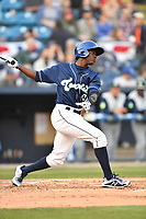 Asheville Tourists center fielder Shael Mendoza (21) swings at a pitch during a game against the Columbia Fireflies at McCormick Field on April 12, 2018 in Asheville, North Carolina. The Fireflies defeated the Tourists 7-5. (Tony Farlow/Four Seam Images)