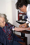 Nurse drawing blood from patient for testing