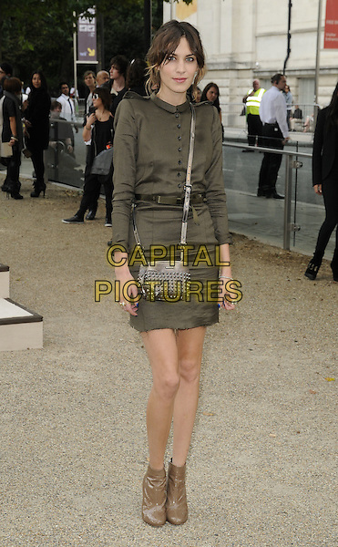 ALEXA CHUNG .attending the Burberry Prorsum Spring Summer Collection, during London Fashion Week at the Chelsea College of Art and Design, London, England, UK, September 21st 2010..LFW show full length grey gray green black brown khaki dress cross body bag studded studs ankle boots shirt military collar belt silver .CAP/CAN.©Can Nguyen/Capital Pictures.