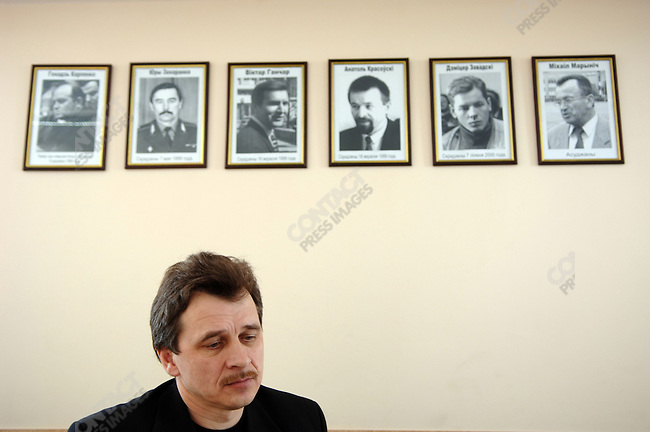 One of the main opposition leaders Anatoly Lebedko, head of the United Civil Party of Belarus, in his office under the portraits of opposition figures who have myesteriously disappeared.  Today he was one of several opposition leaders accused by the head of Belarussian security services of being implicated in a terrorist plot.