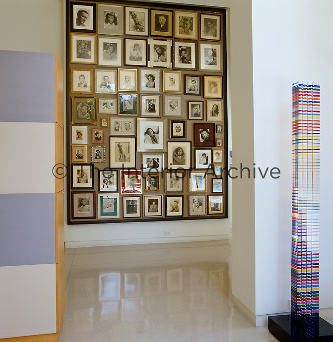 A collection of signed Hollywood photographs is mounted on a wall opposite the entrance